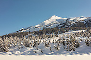Deep snow in late winter blankets the alpine at Turnagain Pass in Southcentral Alaska. Afternoon.