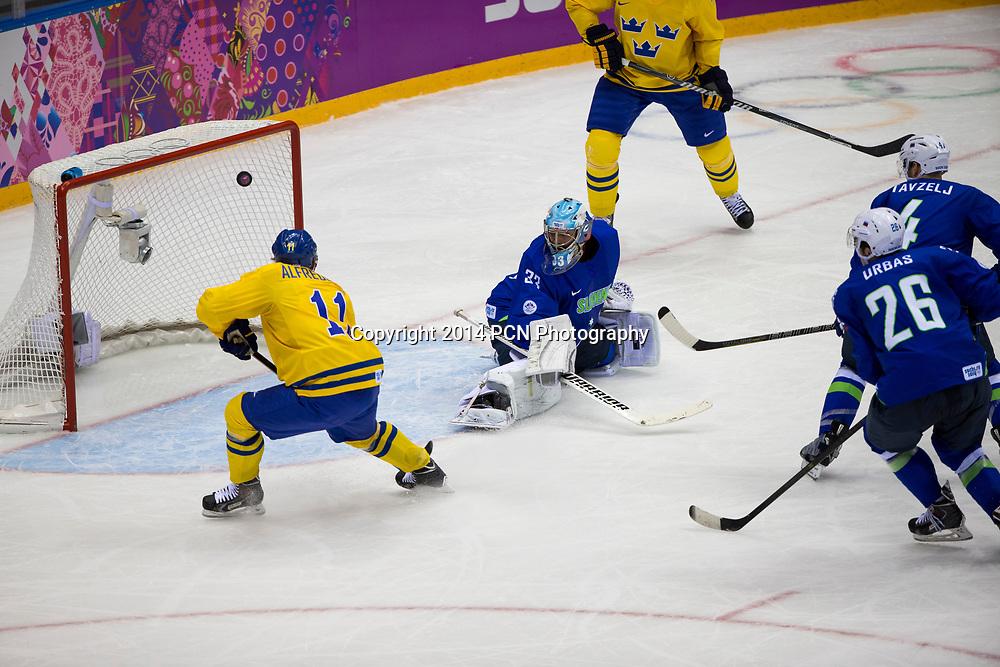 Goalie Robert Kristan (SLO)-33, Daniel Alfredsson (SWE)-11 during Sweden vs Slovenia game at the Olympic Winter Games, Sochi 2014