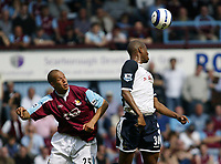 Photo: Chris Ratcliffe.<br /> West Ham United v Tottenham Hotspur. The Barclays Premiership. 07/05/2006.<br /> Bobby Zamora (L) of West Ham tussles with Anthony Gardner of Spurs.