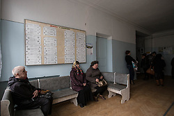 Residents of Zorinsk wait their turn to consult one of the mSF doctors at the mobile clinic that has come to their town near Lugansk.
