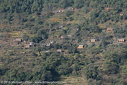 Terraced fields and hillside homes along our route on the first morning of our Himalayan Heroes adventure, Nepal. Tuesday, November 6, 2018. Photography ©2018 Michael Lichter.