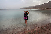 Young Female tourist relaxing at the Blue Lagoon resort (Dahab), Sinai, Egypt