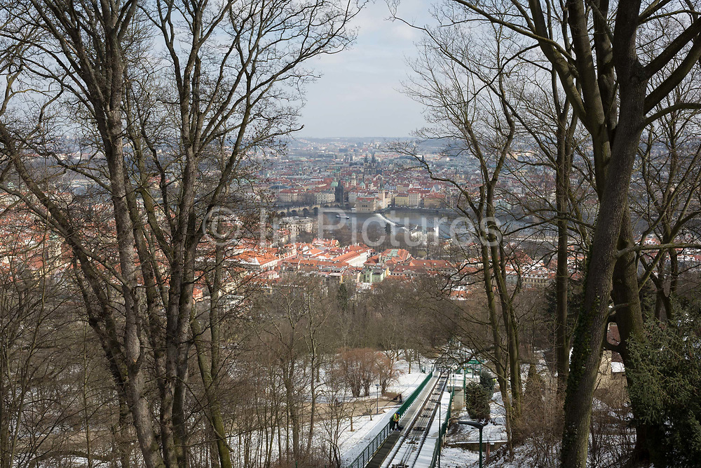 The city of Prague seen from across the Vltava river, the adjacent hillside of Hradcany district which features a funicular railway that climbs up to the castle area, on 19th March, 2018, in Prague, the Czech Republic. Like Rome, the Czech capital is built on seven hills.