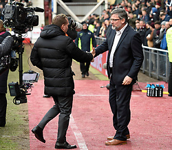 Celtic manager Brendan Rodgers (left) shakes hands with Hearts manager Craig Levein before the Ladbrokes Scottish Premiership match at Tynecastle Stadium, Edinburgh. PRESS ASSOCIATION Photo. Picture date: Sunday December 17, 2017. See PA story SOCCER Hearts. Photo credit should read: Ian Rutherford/PA Wire. EDITORIAL USE ONLY