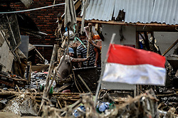 September 23, 2016 - Garut, Indonesia - Villagers save valuables in their homes in Garut district, West Java province on September 23, 2016, two days after a series of landslides and flash floods hit several areas. The death toll from devastating floods and landslides in Indonesia has risen to 26, an official said, with hopes fading for 19 others still missing. (Credit Image: © Dasril Roszandi/NurPhoto via ZUMA Press)