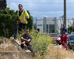 May 1, 2019 - Ontario, California, U.S. - A Ontario, Calif. recycling facility fire drew a crowd Tuesday afternoon, April 30, 2019. Several, like Jose Gonzalez, standing left, said it was the second time he's seen it ablaze. Photographed at S. Taylor Ave. and Ontario Blvd. (Credit Image: © Cindy Yamanaka/SCNG via ZUMA Wire)