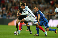 Dele Alli of England breaks away from Stanislav Lobotka of Slovakia. FIFA World cup qualifying match, European group F, England v Slovakia at Wembley Stadium in London on Monday 4th September 2017.<br /> pic by Andrew Orchard, Andrew Orchard sports photography.