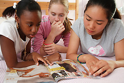Group of teenagers with magazine.