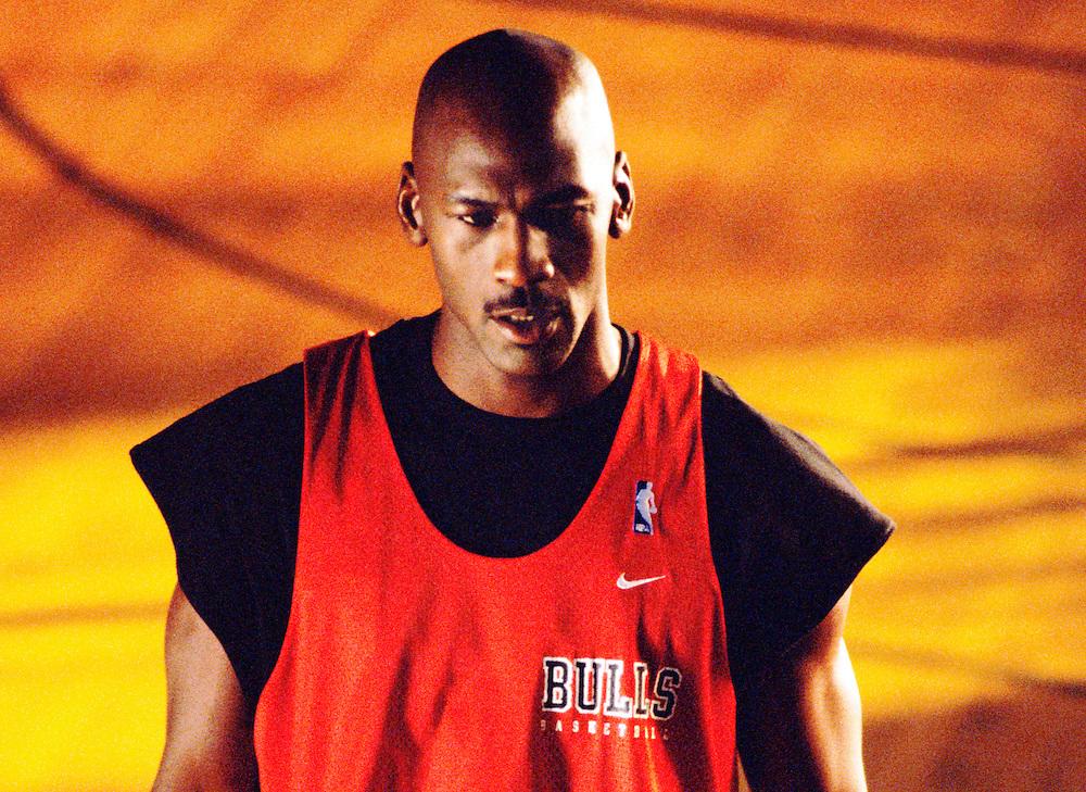 Michael Jordan, basketball superstar, photographed in practice attire on baskeball court during Chicago Bulls' final season championship run, 1998, Chicago, Illinois, USA