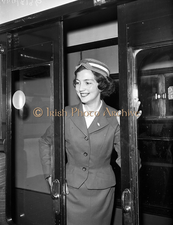 """20/05/1959<br /> 05/20/1959<br /> 20 May 1959<br /> New C.I.E. Rail Hostesses. """"Can I Help you?"""". Betty Vernon (Bannogher Co. Offaly) on her rounds."""