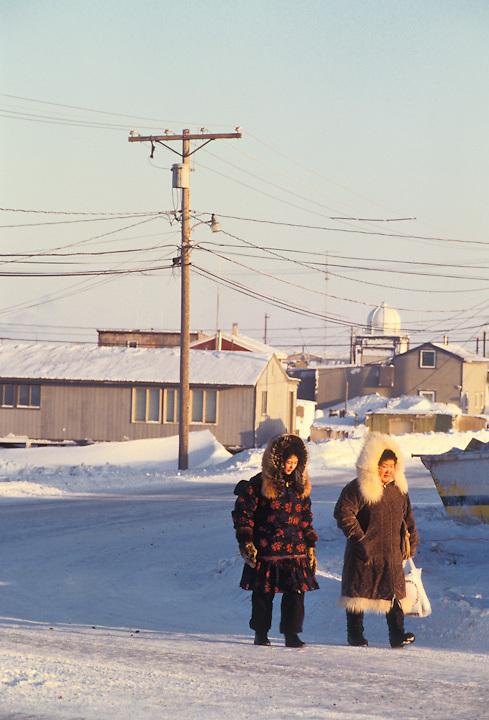 Two women return home in the Iñupiat village of Barrow, Alaska.