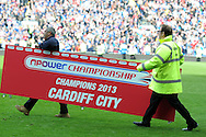 ground staff bring on the sponsors branding ready for the trophy presentation. NPower championship, Cardiff city v Bolton Wanderers at the Cardiff city Stadium in Cardiff, South Wales on Saturday 27th April 2013. pic by Andrew Orchard,  Andrew Orchard sports photography,