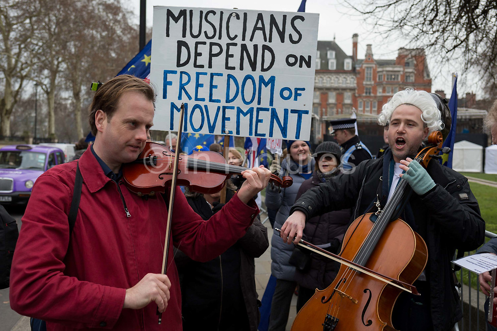A violinist and cellist play opposite the UK parliament to protest against Brexit and how musicians will be hampered as they travel around the EU for concerts and performances, on 10th January 2019, in London, England.