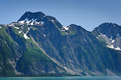 Kayakers approach tiny Garforth Island as they cross Muir Inlet from Caroline Point to Mount Wright (pictured) near Adams Inlet in Glacier Bay National Park and Preserve in southeast Alaska.