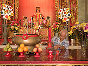 15 NOVEMBER 2016 - GEORGE TOWN, PENANG, MALAYSIA: A volunteer cleans an alter in the Temple of the Goddess of Mercy in George Town, Penang. George Town is a UNESCO World Heritage city and wrestles with maintaining its traditional lifestyle and mass tourism.           PHOTO BY JACK KURTZ