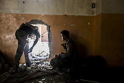 July 2, 2017 - Mosul, Iraq - ISOF CTF troops watch as newly liberated Mosul residents make their way through the Old City neighborhood in droves amidst the rubble near Al-Nuri Mosque days after the Iraqi government declared the Islamic State was defeated. (Credit Image: © Byron Smith via ZUMA Wire)