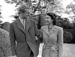 HRH Princess Elizabeth (r) enjoys a stroll with her husband, HRH The Duke of Edinburgh (l)