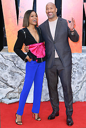 Naomie Harris (left) and Dwayne Johnson attending the European premiere of Rampage, held at the Cineworld in Leicester Square, London. Photo credit should read: Doug Peters/EMPICS Entertainment