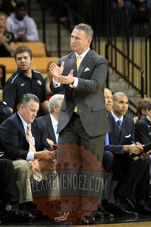 Head coach Donnie Jones of the University of Central Florida Knights mens basketball team claps against the West Florida Argonauts in the first home game of the 2010 season at the UCF Arena on November 12, 2010 in Orlando, Florida. UCF won the game 115-61. (AP Photo/Alex Menendez)