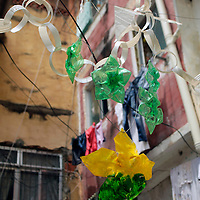 South America, Brazil. Rio de Janiero. Favela of Vila Canoas, decorated with recycled objects.