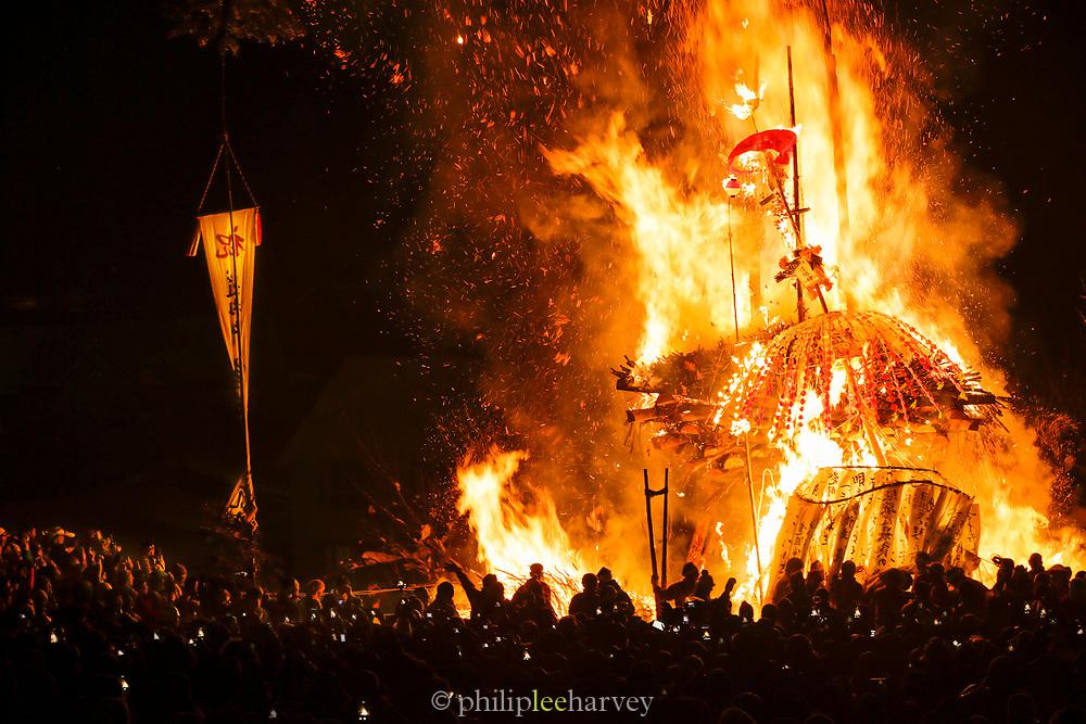 Burning shrine during Fire Festival in Nozawaonsen, Japan