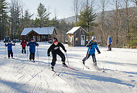 The Alton Central School nordic team gets fired up on the trails at Gunstock Thursday afternoon.  (l-r) Blake Pappaceno, Derek Pappaceno, Kenny Fontaine, Nathan Archambault and Mason Pappaceno.  (Karen Bobotas/for the Laconia Daily Sun)