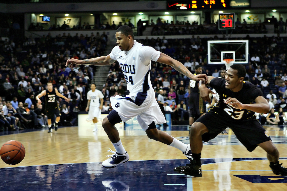 Jan 7, 2012; Norfolk, VA, USA; Old Dominion Monarchs guard/forward Kent Bazemore (24) and Towson Tigers forward Deon Jones (23) battle for a loose ball at the Ted Constant Convocation Center. Mandatory Credit: Peter Casey-US PRESSWIRE