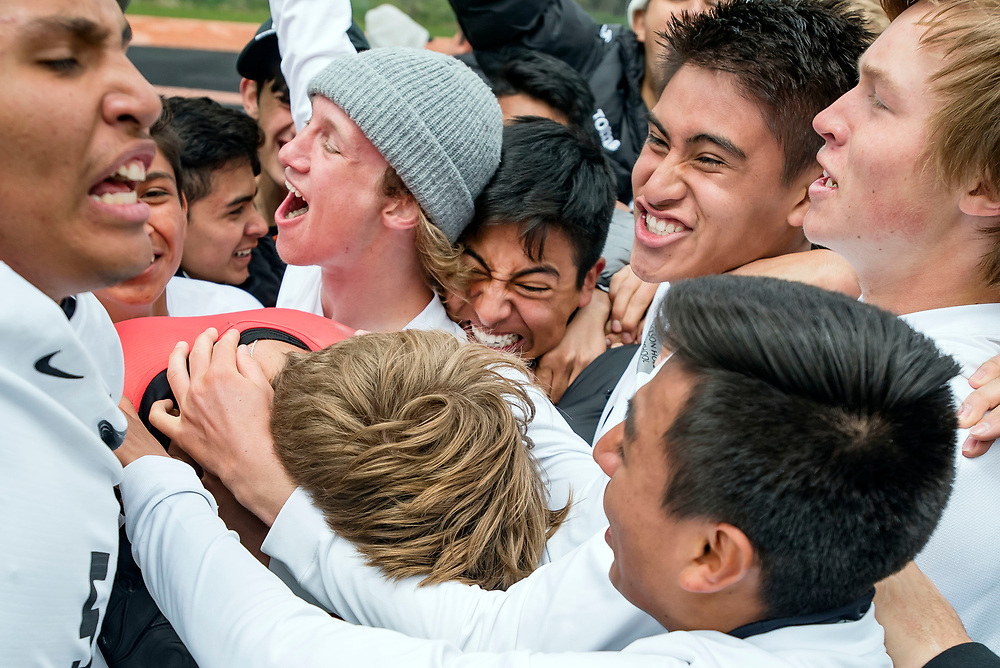 The Jackson Broncs boy's soccer team celebrate advancing to the championship after Jackson's 2-2 (4-3 shootout) victory against Star Valley in the semifinal round of the Class 4A state soccer tournament at William T. McIntosh Stadium in Jackson, Wyoming on Friday, May 17, 2019. The Broncs went on to beat Thunder Basin in the championship and brought home the state title. (Rebecca Noble/Jackson Hole News&Guide)