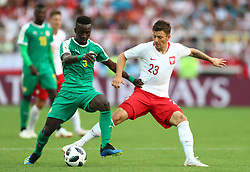 Senegal's Mame Biram Diouf (left) and Poland's Dawid Kownacki