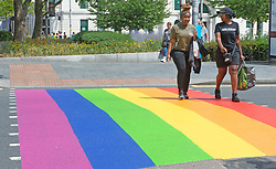 ©Licensed to London News Pictures 16/06/2020<br /> Woolwich, UK. A colourful crossing in Woolwich town centre, Woolwich. Rainbow pedestrian crossings return to Greenwich Borough to show support for Gay pride month. Crossings in Eltham,Greenwich, plumstead,Charlton and Woolwich have had a rainbow make over bringing some colour to the streets in South East London. Photo credit: Grant Falvey/LNP