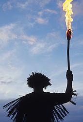 United States, Hawaii, Kauai, man holding torch during luau on beach