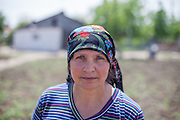 Portrait of a local inhabitant working on her field in the Roma area of Frumusani.