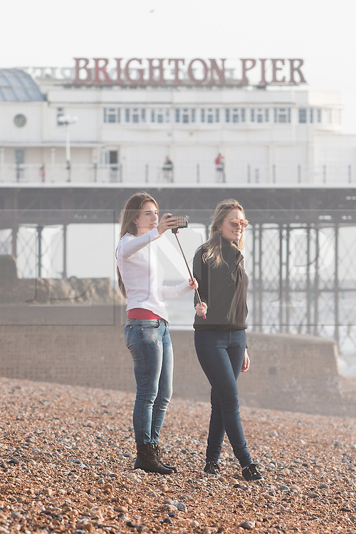 © Licensed to London News Pictures. 19/12/2015. Brighton, UK. people relax on Brighton beach as the weather is warmer then usual and temperatures are hitting 14C . Today December 19th 2015. Photo credit: Hugo Michiels/LNP
