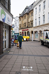 Social distancing markings on the pavement in Norwich during Coronavirus lockdown in advance of the reopening of shops on 15 June 2020. UK