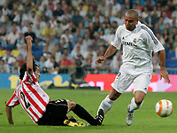 Real Madrid's Ronaldo in actyion against Athletic de Bilbao's Unai Exposito during Spanish League game between Real Madrid and Athletico de Bilbao in Santiago Bernabeu stadium in Madrid, Spain, Thursday 22 September, 2005. (Photo / Alvaro Hernandez)