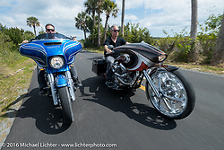 Zach Ness rides next to his dad Cory Ness (on his side-by-side twin engine custom) into Tomoka State Park during the Daytona Bike Week 75th Anniversary event. FL, USA. Monday March 7, 2016.  Photography ©2016 Michael Lichter.