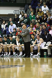 29 January 2011: Ron Rose in front of the Titan bench during an NCAA basketball game between the Carthage Reds and the Illinois Wesleyan Titans at Shirk Center in Bloomington Illinois.