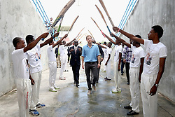 Prince Harry is saluted by young cricket players as he attends a youth sports festival at the Sir Vivian Richards Stadium in North Sound, Antigua, on the second day of his tour of the Caribbean.