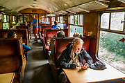 From Grosmont we take a steam-hauled train through North York Moors National Park to Pickering on the North Yorkshire Moors Railway, in North Yorkshire county, England, United Kingdom, Europe. Along the way, see Goathland station, the setting for fictional Hogsmeade Station for the Hogwarts Express in Harry Potter films. England Coast to Coast hike day 12 of 14. [This image, commissioned by Wilderness Travel, is not available to any other agency providing group travel in the UK, but may otherwise be licensable from Tom Dempsey – please inquire at PhotoSeek.com.]