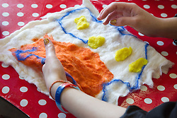 Felt making class for people with a visual impairment - feeling pocket in felted wool design.