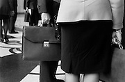 Business man and woman with briefcase