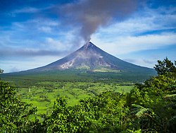 January 30, 2018 - Legazpi, Albay, Philippines - The Mayon volcano, as seen from Legazpi, sends a cloud of ash into the sky. Mayon volcano continued to erupt but not as dramatically as it did last week. The small eruptions are still sending ash clouds over communities west of the volcano and the government is encouraging people to stay indoors, wear face masks and avoid strenuous activities when ash is falling. (Credit Image: © Jack Kurtz via ZUMA Wire)