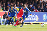 Dannie Bulman midfielder of AFC Wimbledon (4) takes a tumble during the Sky Bet League 2 match between AFC Wimbledon and Leyton Orient at the Cherry Red Records Stadium, Kingston, England on 23 April 2016. Photo by Stuart Butcher.