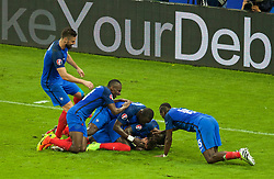 PARIS, FRANCE - Sunday, July 3, 2016: France's Antoine Griezmann celebrates scoring the fourth goal against Iceland with team-mates boot during the UEFA Euro 2016 Championship Semi-Final match at the Stade de France. (Pic by Paul Greenwood/Propaganda)