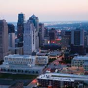 Aerial photo of downtown Kansas City, Missouri buildings and skyline at dusk.