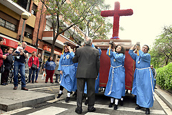 May 5, 2018 - L´Hospitalet De Llobregat, Catalonia, Spain - A group of women of the 15 + 1 Brotherhood seen carrying the Cross of the Christ during the procession of the May Cross as a celebrations within the Roman rite to celebrate the cult of the Cross of Christ..The 15 + 1 brotherhood of L'Hospitalet City has celebrated this Saturday the procession of the May Cross next to the 'Virgin of the Remedies' as part of an important yearly religious event. (Credit Image: © Ramon Costa/SOPA Images via ZUMA Wire)