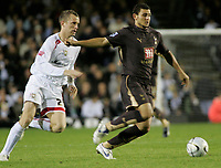 Photo: Marc Atkins.<br /> Milton Keynes Dons v Tottenham Hotspur. Carling Cup. 25/10/2006. Hossam Ghaly of Spurs (R) is challenged by Aaron Wilbraham of MK Dons (L).