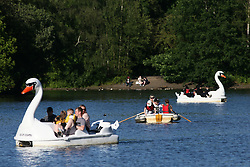 © Licensed to London News Pictures. 12/06/2021. Manchester, UK.  People cruise around in pedalos on the boating lake at Heaton Park in north Manchester on Saturday afternoon. Photo credit: Adam Vaughan/LNP