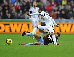 West Ham United's Mark Noble tackles Swansea City's Jonathan de Guzman - Photo mandatory by-line: Joe Meredith/JMP - Tel: Mobile: 07966 386802 27/10/2013 - SPORT - FOOTBALL - Liberty Stadium - Swansea - Swansea City v West Ham United - Barclays Premier League