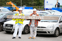 Workmen hold a sign welcoming back Wayne Rooney at Goodison Park, Liverpool.